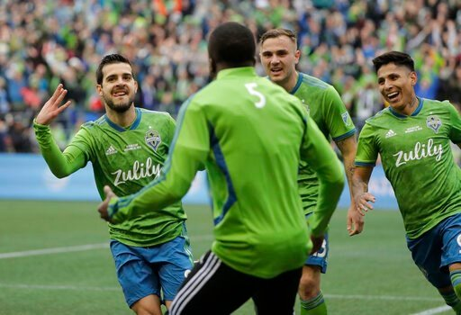 (AP Photo/Ted S. Warren). Seattle Sounders' Victor Rodriguez, left, celebrates with teammates after scoring against the Toronto FC, Sunday, Nov. 10, 2019, during the second half of the MLS Cup championship soccer match in Seattle.