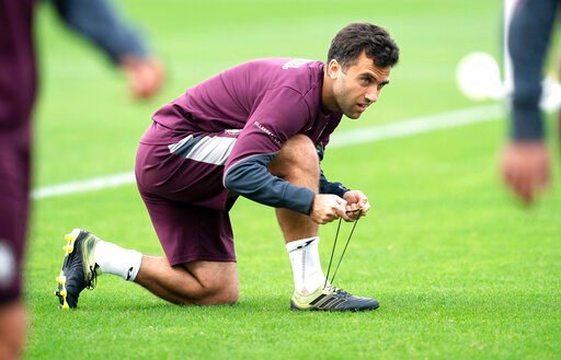 (Villareal F.C via AP). In this photo released by Villarreal Club de Futbol on Tuesday, Oct. 15, 2019, Giuseppe Rossi laces up his sneakers during a training with Spanish club Villarreal, Spain.  The 32-year old Rossi, the American-born striker who pla...