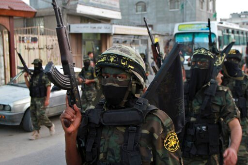 (AP Photo/Adel Hana, File). FILE - In this Oct. 2, 2012 file photo, masked militants of the Islamic Jihad group march during a rally marking the 17th anniversary of the death of the group's leader Fathi Shekaki, in Rafah Refugee camp in the southern Ga...