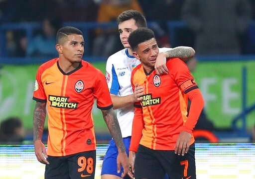 (AP Photo/Oleksandr Osipov). Shakhtar's Brazilian player Taison, right, reacts as he leaves the pitch after he was red-carded for his reaction on racial abuse, while Dynamo Kyiv Mykola Shaparenko, center, calmed him down, during Premier League soccer m...