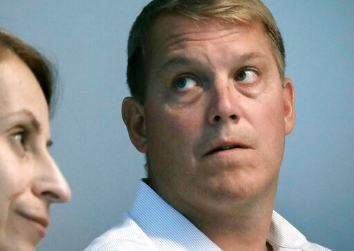 (AP Photo/Bebeto Matthews, File). FILE - In this Aug. 20, 2019 file photo, Scott Hapgood, right, a U.S. financial adviser charged with killing a hotel worker while on vacation in Anguilla, and his lawyer Juliya Arbisman, left, hold a media conference i...