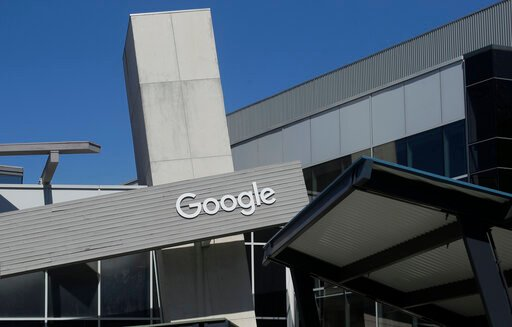 (AP Photo/Jeff Chiu, File). FILE - This Sept. 24, 2019, file photo shows a Google sign on the campus in Mountain View, Calif. Google is working with large health care system Ascension. The partnership is intended to use artificial intelligence to find ...