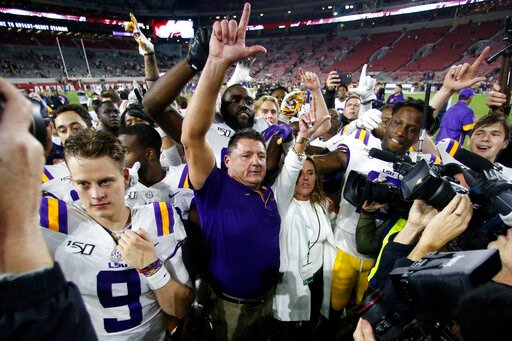 (AP Photo/John Bazemore). LSU head coach Ed Orgeron celebrates with his players after defeating Alabama 46-41 in an NCAA college football game, Saturday, Nov. 9, 2019, in Tuscaloosa , Ala.
