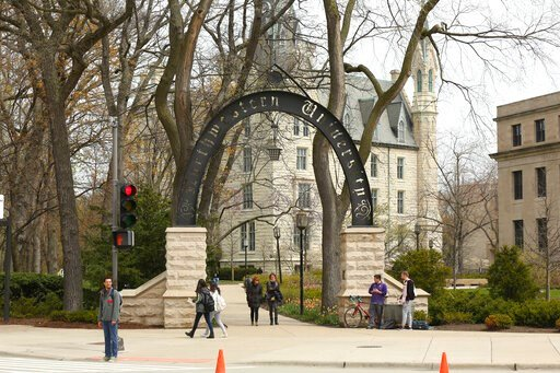 (Chris Walker/Chicago Tribune via AP). In this Friday, April 29, 2016, photo, people stand near the entrance gate to Northwestern University in Evanston, Ill. Northwestern University's student newspaper is under fire. Their first critics came from with...