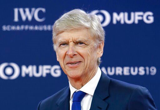 (AP Photo/Claude Paris, File). FILE - In this Monday, Feb. 18, 2019 file photo, former Arsenal soccer team manager Arsene Wenger arrives for the 2019 Laureus World Sports Awards. FIFA says it hired Arsene Wenger in a full-time role leading its global w...