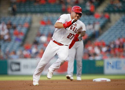 (AP Photo/Alex Gallardo, File). FILE - In this July 30, 2019, file photo, Los Angeles Angels' Mike Trout rounds second to advance to third from first on a single by Shohei Ohtani against the Detroit Tigers during the first inning of a baseball game in ...