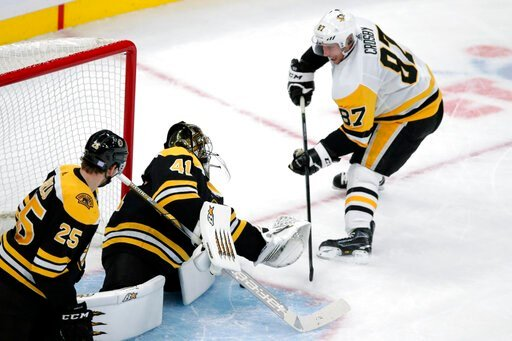 (AP Photo/Charles Krupa). Boston Bruins goaltender Jaroslav Halak (41) makes a save on a shot by Pittsburgh Penguins center Sidney Crosby (87) during the first period of an NHL hockey game in Boston, Monday, Nov. 4, 2019.