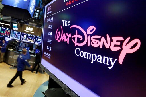 """(AP Photo/Richard Drew, File). FILE - In this Aug. 8, 2017, file photo, The Walt Disney Co. logo appears on a screen above the floor of the New York Stock Exchange. Disney's new streaming service, Disney Plus, is adding a disclaimer to """"Dumbo,"""" """"Peter ..."""