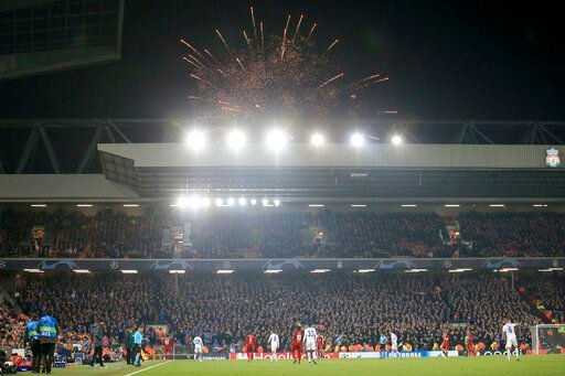 (AP Photo/Jon Super). Guy Fawkes Night fireworks go off outside the stadium during the Champions League group E soccer match between Liverpool and Genk at Anfield Stadium, Liverpool, England, Tuesday, Nov. 5, 2019.