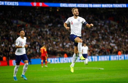(AP Photo/Kirsty Wigglesworth). England's Harry Kane, right, celebrates scoring the fifth goal during the Euro 2020 group A qualifying soccer match between England and Montenegro at Wembley stadium in London, Thursday, Nov. 14, 2019.