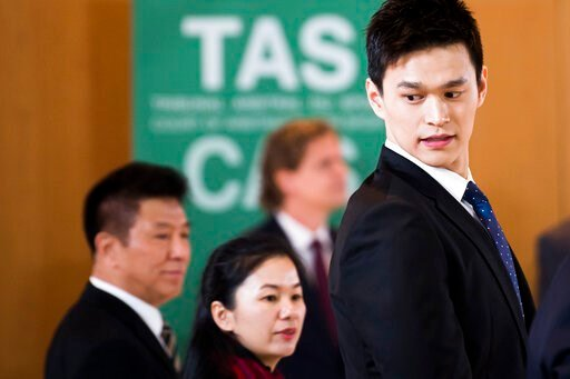 (Jean-Christophe Bott/Keystone via AP). Swimmer Sun Yang, right, from China, arrives for a  public hearing at the Court of Arbitration for Sport (CAS) in Montreux, Switzerland, Friday, Nov. 15 2019. One of China's biggest Olympic stars and three-time g...