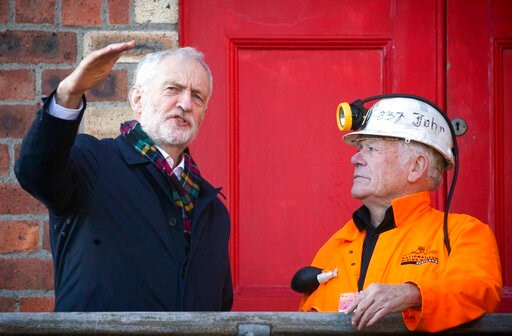 (Jane Barlow/PA via AP). Britain's Labour Party Jeremy Corbyn meets former miner John Kane at the National Mining Museum at the former Lady Victoria Colliery in  Newtongrange, Scotland, Thursday Nov, 14, 2019, on the General Election campaign trail.