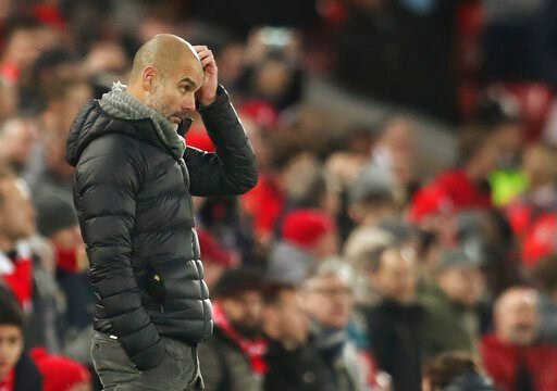 (AP Photo/Jon Super). Manchester City's head coach Pep Guardiola gestures during the English Premier League soccer match between Liverpool and Manchester City at Anfield stadium in Liverpool, England, Sunday, Nov. 10, 2019.
