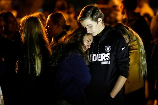 (AP Photo/Marcio Jose Sanchez). Hannah Schooping-Gutierrez, center, a student at Saugus High School, is comforted by her boyfriend Declan Sheridan, at right, a student at nearby Valencia High School during a vigil at Central Park in the aftermath of a ...