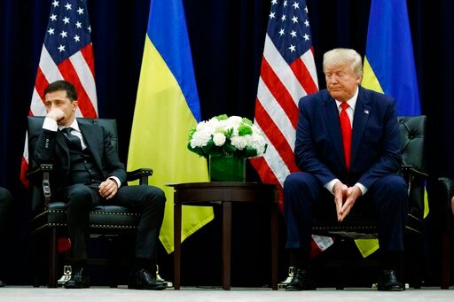 (AP Photo/Evan Vucci, File). FILE - In this Sept. 25, 2019, file photo, President Donald Trump meets with Ukrainian President Volodymyr Zelenskiy at the InterContinental Barclay New York hotel during the United Nations General Assembly in New York. Ukr...