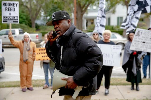 (Nick Wagner/Austin American-Statesman via AP). Rodrick Reed leads a chant during a protest against the execution of Rodney Reed on Wednesday, Nov. 13, 2019, in Bastrop, Texas. Reed is scheduled to be executed Nov. 20, but a growing number of politicia...