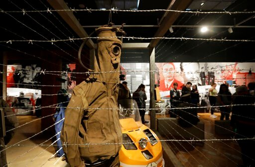 """(AP Photo/Petr David Josek). In this picture taken on Tuesday, Nov. 12, 2019, visitors view the exhibition """"The Technology in Dictatorships,"""" at the National technical Museum in Prague, Czech Republic. The exhibition, the first of that kind here, marks..."""