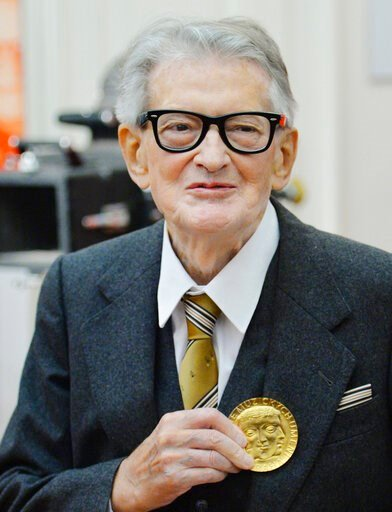 (Michal Dolezal/CTK via AP). FILE - In this November 30, 2015, file photo, Vojtech Jasny, Czech film director and scriptwriter, poses for photographers as he receives gold medal of Academy of Performing Arts in Prague (AMU) on the occasion of his 90th ...