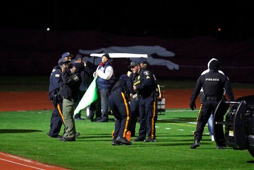 (Edward Lea/The Press of Atlantic City via AP). Police investigate the scene after a gunman shot into a crowd of people during a football game at Pleasantville High School in Pleasantville, N.J., Friday, Nov. 15, 2019. Players and spectators ran for co...
