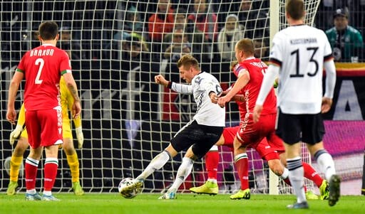 (AP Photo/Martin Meissner). Germany's Toni Kroos scores his side's 4th goal during the Euro 2020 group C qualifying soccer match between Germany and Belarus in Moenchengladbach, Germany, Saturday, Nov. 16, 2019.