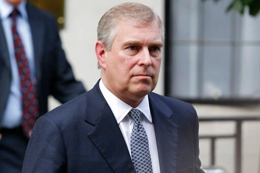 (AP Photo/Sang Tan, File). FILE- In this June 6, 2012 file photo, Britain's Prince Andrew leaves King Edward VII hospital in London after visiting his father Prince Philip.  Prince Andrew says in a BBC interview scheduled to be broadcast Saturday, Nov....