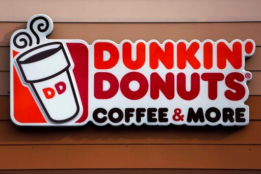 """(AP Photo/Gene J. Puskar, File). FILE- This Jan. 22, 2018 file photo shows the Dunkin' Donuts logo on a shop in Mount Lebanon, Pa. The Dunkin' coffee chain says customers will have to do without a """"double cup"""" for their iced drinks.A new campaign focus..."""