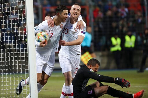 (AP Photo/Francisco Seco). Portugal's Cristiano Ronaldo, left, celebrates with his teammate Diogo Jota after he scored his side's second goal during the Euro 2020 group B qualifying soccer match between Luxembourg and Portugal at the Josy Barthel stadi...