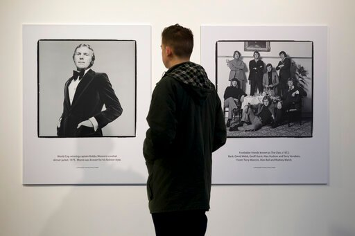 (AP Photo/Jon Super, FILE). FILE - In this file photo dated Thursday Jan. 31, 2013, a man views photographs of footballers by Terry O'Neill are seen on display at the Strike A Pose: 50 Years of Football & Fashion, exhibition preview at the National...