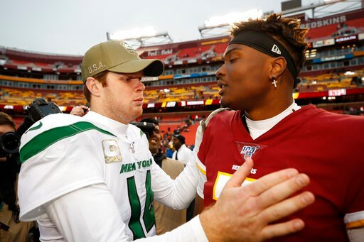 (AP Photo/Alex Brandon). New York Jets quarterback Sam Darnold (14) speaks with Washington Redskins quarterback Dwayne Haskins (7) after an NFL football game, Sunday, Nov. 17, 2019, in Landover, Md. New York Jets won 34-17.