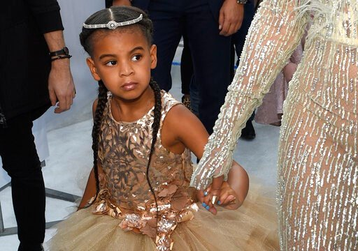 (Photo by Chris Pizzello/Invision/AP, File). FILE - In this Aug. 28, 2016 file photo, Blue Ivy, daughter of Beyonce, arrives at the MTV Video Music Awards at Madison Square Garden in New York. At just 7, Blue Ivy Carter is an award-winning songwriter. ...