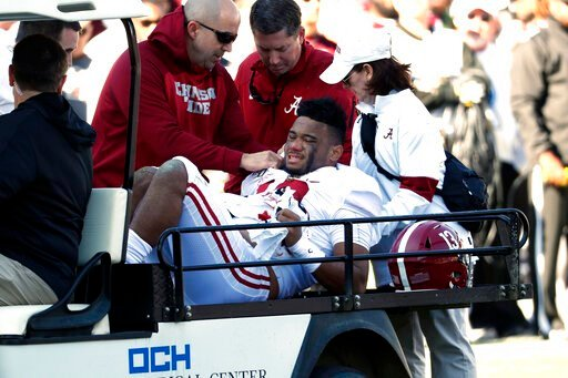 (AP Photo/Rogelio V. Solis). Alabama quarterback Tua Tagovailoa (13) is carted off the field after getting injured in the first half of an NCAA college football game against Mississippi State in Starkville, Miss., Saturday, Nov. 16, 2019.