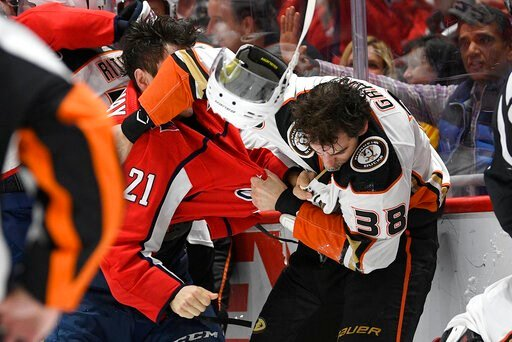 (AP Photo/Nick Wass). Washington Capitals right wing Garnet Hathaway (21) fights Anaheim Ducks center Derek Grant (38) during the second period of an NHL hockey game, Monday, Nov. 18, 2019, in Washington.
