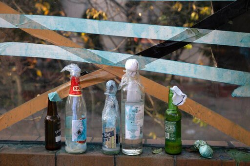 (AP Photo/Ng Han Guan). Molotov cocktails are left over at the Hong Kong Polytechnic University campus in Hong Kong on Tuesday, Nov. 19, 2019. Police tightened their siege of the university campus where hundreds of protesters remained trapped overnight...