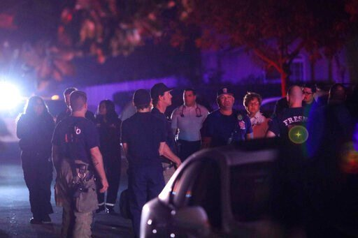 (Larry Valenzuela//The Fresno Bee via AP). Police and emergency personnel are on the scene of a shooting at a backyard party, Sunday, Nov. 17, 2019, in southeast Fresno, Calif. Multiple people were shot and at least four of them were killed Sunday at a...