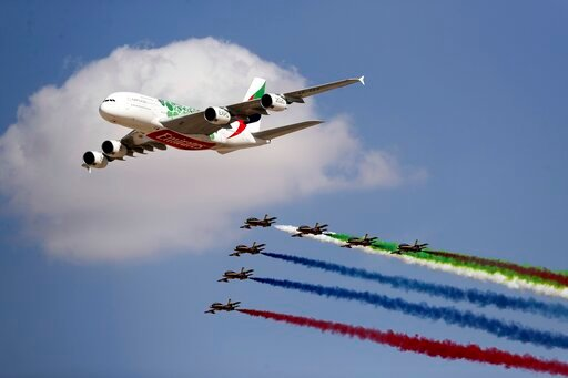 "(AP Photo/Kamran Jebreili). An Emirates Airline A-380 leads the ""Al Fursan"", or the Knights, a UAE Air Force aerobatic display team during the opening day of the Dubai Airshow, in Dubai, United Arab Emirates, Sunday, Nov. 17, 2019. The biennial airshow..."