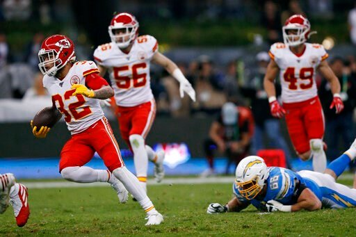 (AP Photo/Rebecca Blackwell). Kansas City Chiefs strong safety Tyrann Mathieu, right, runs after an interception during the first half of an NFL football game against the Los Angeles Chargers, Monday, Nov. 18, 2019, in Mexico City.