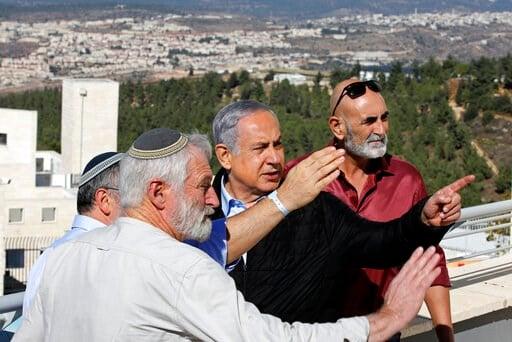 (Menahem Kahana/Pool via AP). Israeli Prime Minister Benjamin Netanyahu, center, meets with heads of Israeli settlement authorities at the Alon Shvut settlement, in the Gush Etzion block, in the occupied the West Bank, Tuesday, Nov. 19, 2019.