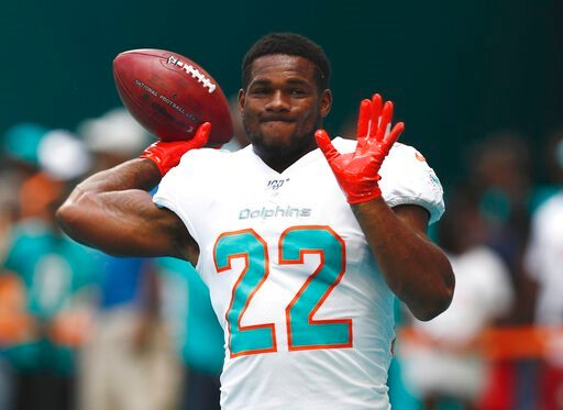 (AP Photo/Brynn Anderson, File). FILE - In this Sept. 8, 2019, file photo, Miami Dolphins running back Mark Walton (22) warms up before an NFL football game against the Baltimore Ravens, in Miami Gardens, Fla. The Dolphins have released troubled runnin...
