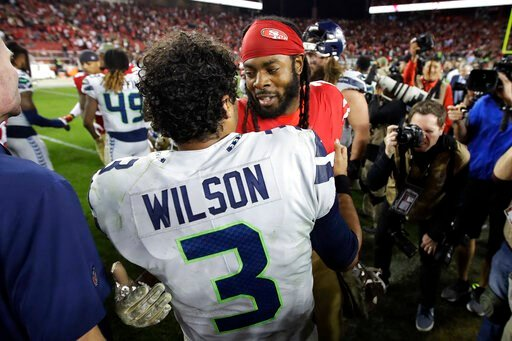 (AP Photo/Ben Margot). Seattle Seahawks quarterback Russell Wilson (3) greets San Francisco 49ers cornerback Richard Sherman after an NFL football game in Santa Clara, Calif., Monday, Nov. 11, 2019. The Seahawks won 27-24 in overtime.