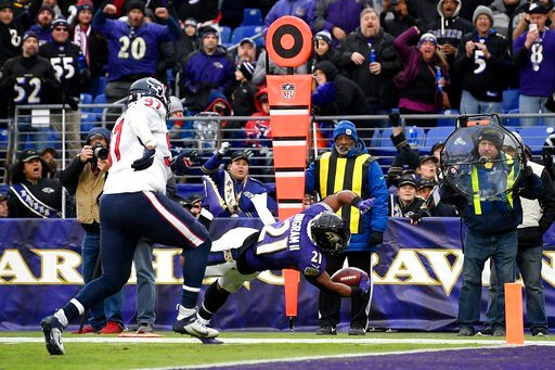 (AP Photo/Nick Wass). Baltimore Ravens running back Mark Ingram (21) dives in for a touchdown on a pass from quarterback Lamar Jackson, not visible, during the second half of an NFL football game against the Houston Texans, Sunday, Nov. 17, 2019, in Ba...