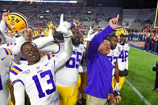 (AP Photo/Thomas Graning). LSU coach Ed Orgeron and players celebrate after an NCAA college football game against Mississippi in Oxford, Miss., Saturday, Nov. 16, 2019. No. 1 LSU won 58-37.