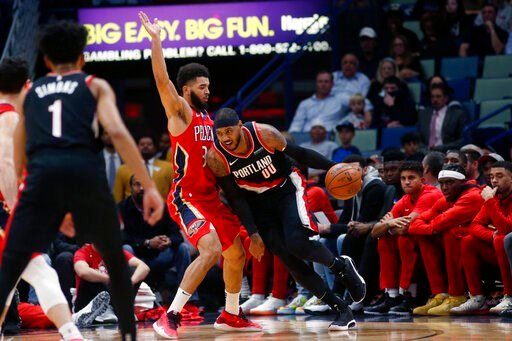 (AP Photo/Gerald Herbert). Portland Trail Blazers forward Carmelo Anthony (00) drives to the basket against New Orleans Pelicans guard Josh Hart (3) in the first half of an NBA basketball game in New Orleans, Tuesday, Nov. 19, 2019.