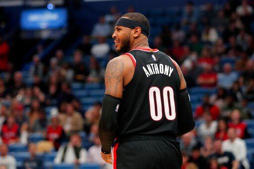 (AP Photo/Gerald Herbert). Portland Trail Blazers forward Carmelo Anthony (00) looks to a few for a foul after driving to the basket in the second half of an NBA basketball game against the New Orleans Pelicans in New Orleans, Tuesday, Nov. 19, 2019. T...