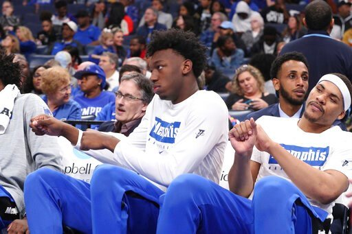 (AP Photo/Karen Pulfer Focht). Memphis' James Wiseman, second from right, sits out the game along with Isaiah Stokes, right, in an NCAA college basketball game against Alcorn State Saturday, Nov. 16, 2019, in Memphis, Tenn. Malcolm Dandridge is first f...