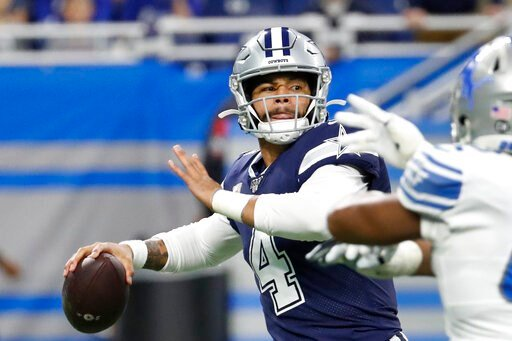 (AP Photo/Rick Osentoski). Dallas Cowboys quarterback Dak Prescott (4) is pressured during the first half of an NFL football game against the Detroit Lions, Sunday, Nov. 17, 2019, in Detroit.