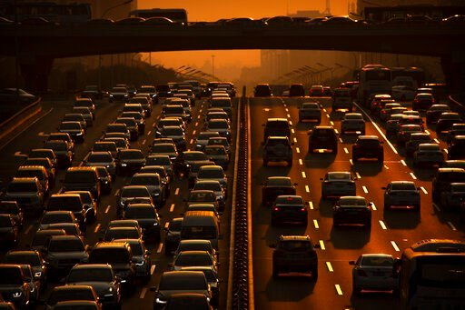 (AP Photo/Mark Schiefelbein, file). File - In this Friday, Sept. 6, 2019 file photo, commuters make their way along an expressway during rush hour in Beijing. According to Chinese state media, the average concentration of PM2.5 fine air pollutants in B...