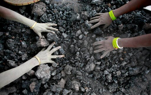 (AP Photo/ Anupam Nath, File). FILE - In this Monday, Dec. 14, 2015, file photo, Indian women use bare hands to pick reusable pieces from heaps of used coal discarded by a carbon factory in Gauhati, India. Inger Andersen, head of the U.N. Environment P...