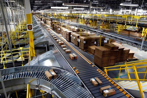(AP Photo/Patrick Semansky, File). FILE- In this Aug. 3, 2017, file photo, packages ride on a conveyor system at an Amazon fulfillment center in Baltimore. Amazon, Walmart and others are promising to deliver more of their goods in a day and this holida...