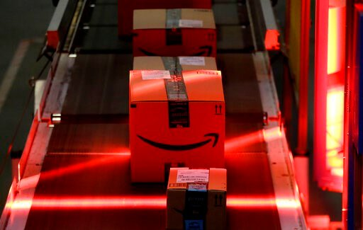 (AP Photo/Julio Cortez, File). FILE - In this Aug. 1, 2017, file photo, packages riding on a belt are scanned to be loaded onto delivery trucks at the Amazon Fulfillment center in Robbinsville Township, N.J. Amazon, Walmart and others are promising to ...