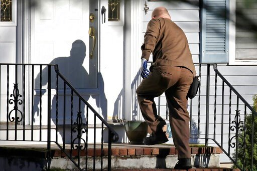 (AP Photo/Elise Amendola). In this Nov. 26, 2019, file photo a UPS man delivers an Amazon package to a residence in North Andover, Mass. Amazon, Walmart and others are promising to deliver more of their goods in a day and this holiday season will be th...